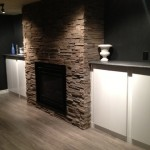Installation of floor cabinets, fireplace and stone
