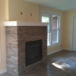 Old porch, transformed intoSunroom with natural gas fireplace